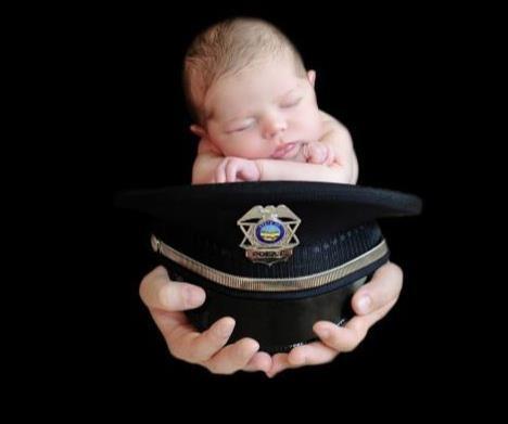 Infant on Police Hat