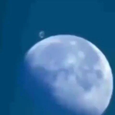 UFO Behind Moon